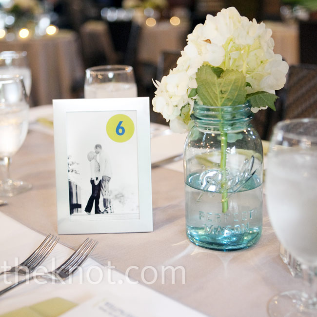 The couple's engagement photos were numbered and placed in silver frames to serve as table numbers.