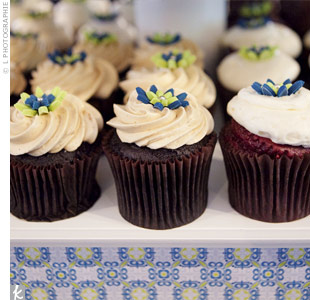 Unable to pick just one, Julie and Matt chose five flavors of cupcakes for their guests to enjoy. Each cupcake was topped with a teal and green frosting flower.