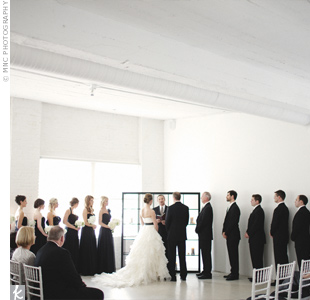 Not wanting to distract from the space, the couple kept the ceremony setup simple with white chiavari chairs and a square black frame.