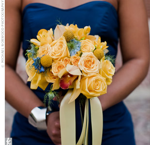 Some blue thistle accented the yellow bouquets of roses, craspedia and cymbidium orchids.