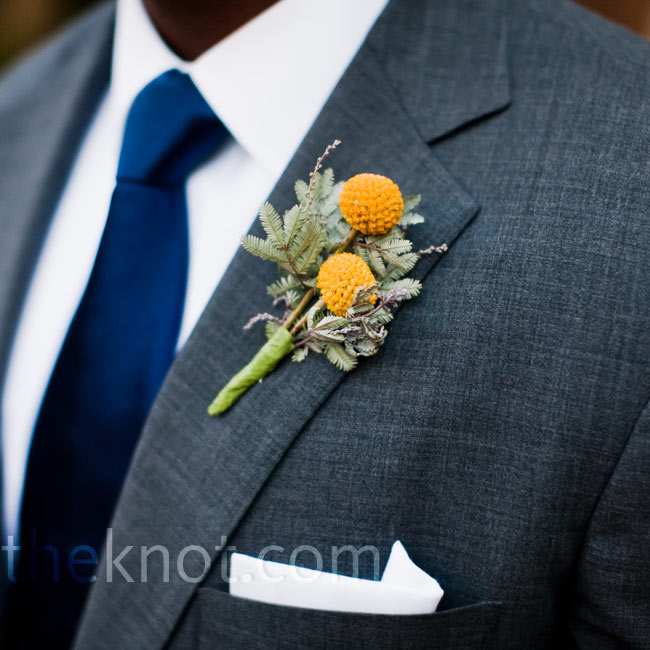 The groomsmen's yellow craspedia boutonnieres were framed with pine sprigs for a fun, fall twist.