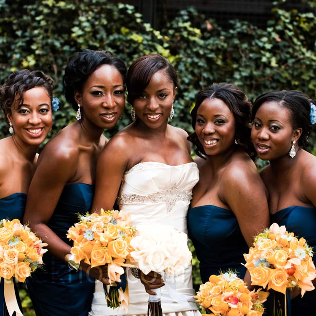 The four bridesmaids wore strapless dresses and accessorized with earrings.
