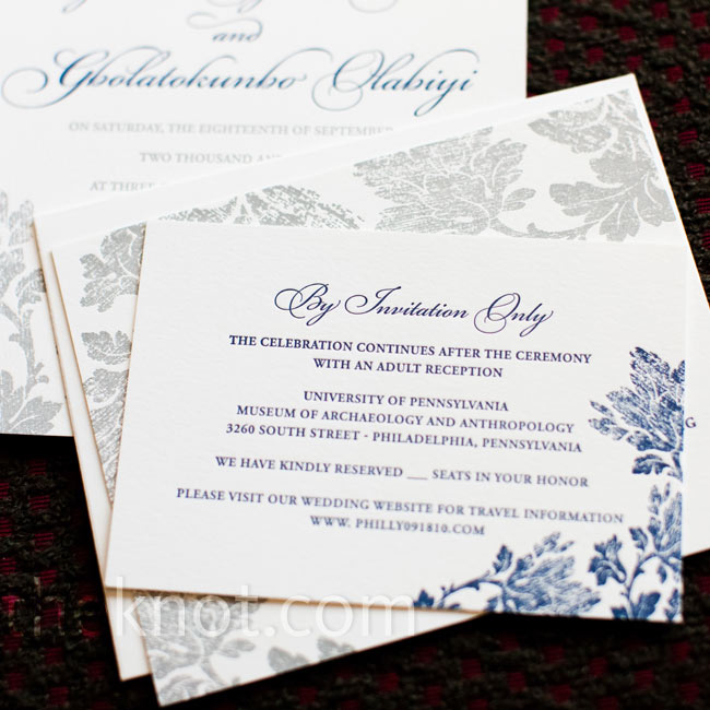 Letterpress invitations with a delicate leaf motif and a navy font had an elegant look.