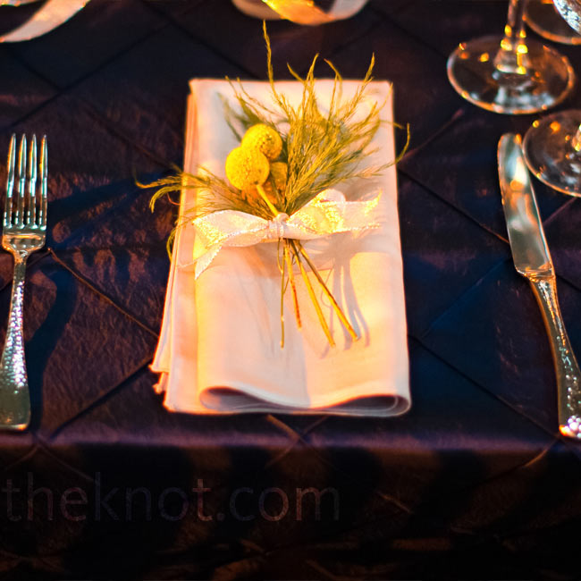 Craspedia and greens added a natural touch to the silver place settings and rich navy patterned linens.