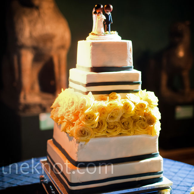 A center tier of yellow roses made a nice block of color on the navy and white cake.
