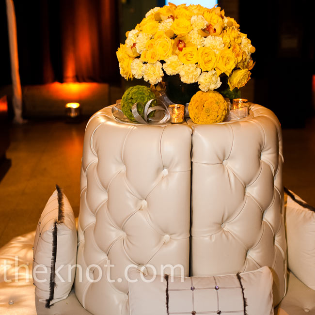 Modern leather furniture made up the lounge area at the reception, while big arrangements of yellow roses added some color.