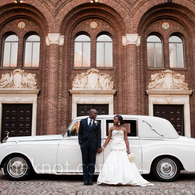 Bola rode to the ceremony in this white vintage Rolls-Royce.