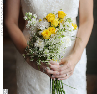Tiffany carried a farm fresh bouquet of Queen Anne's lace, stock and yellow spray roses.