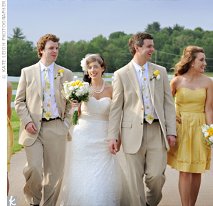 The groomsmen wore floral ties to match the bright yellow bridesmaid dresses.