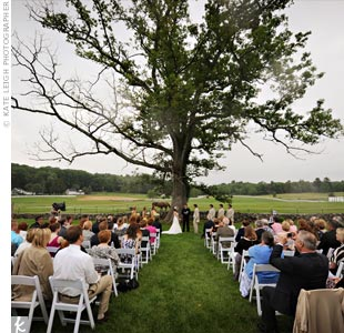 Tiffany and Ryan exchanged vows outside under a tall tree in the pasture.