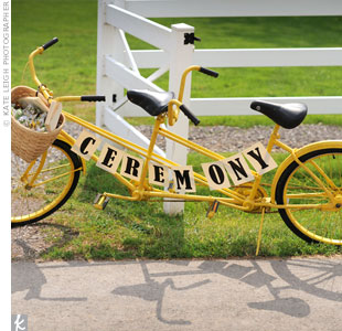 Tiffany and Ryan found a vintage tandem bike in the perfect shade of yellow at an antiques shop. They added a banner and made it the welcome point at the ceremony.