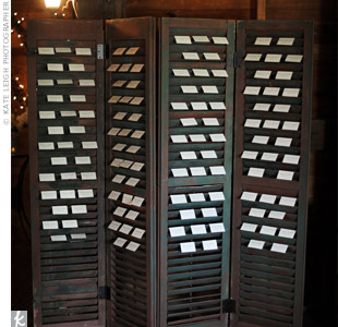 Simple escort cards were slid into the slats of antique shutters for a rustic look.