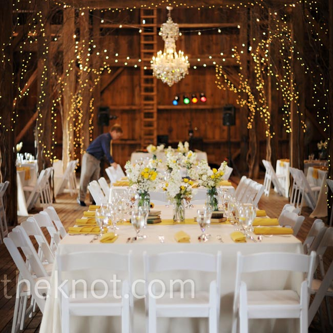 For added elegance, a chandelier hung above the couple's table and twinkle lights were strung from the wood-beamed ceiling.