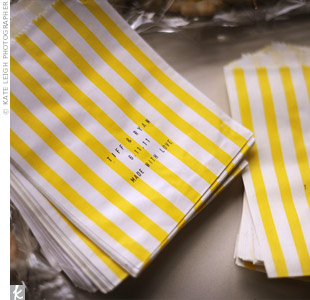 At the end of the night, guests filled these white and yellow goodie bags with cookies made by Ryan's aunt.