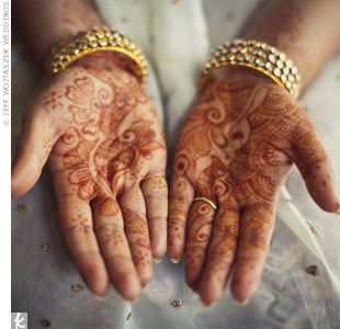 Rupal had henna tattoos, the sign of a new Indian bride, painted on her palms