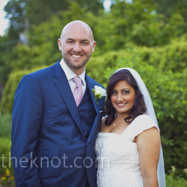 For her white gown, Rupal wore a Sue Wong dress with added satin cap sleeves. Matt chose a navy-blue suit and a pink Hermès tie.