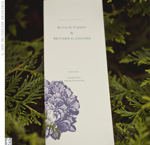 The simple, tall ceremony programs featured a dark-purple hydrangea and a modern typeface.