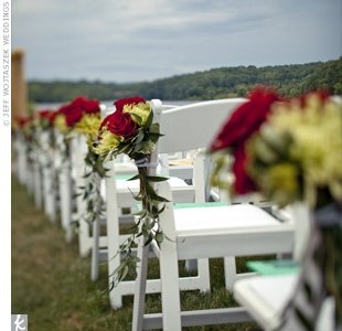 Red roses and yellow spider mums decorated the ceremony chairs.