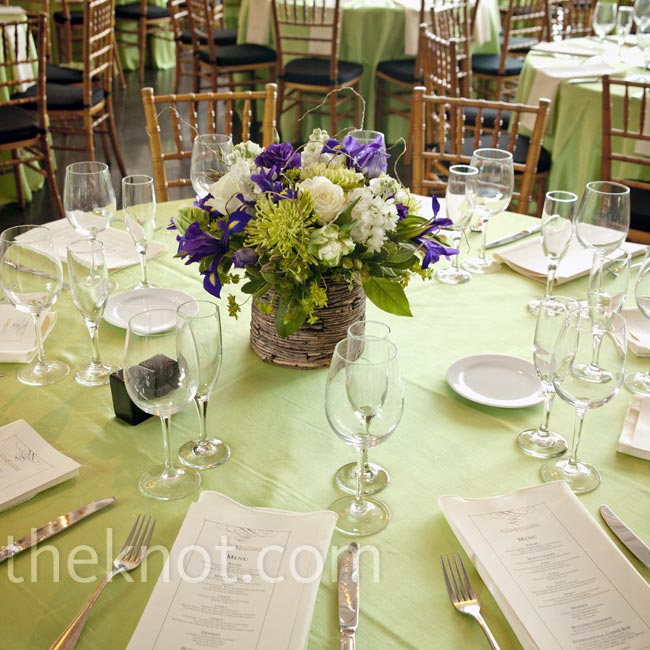 Green bengaline linens topped the tables for a fresh look, while birch bark planters holding irises and white tulips brought a bit of the lakeside location inside.