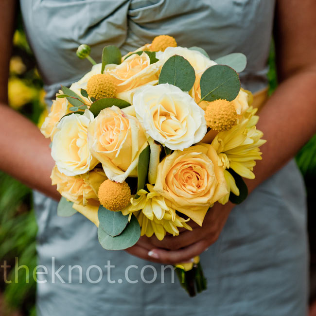 All-yellow bouquets of craspedia, roses and daisies looked great with the girls' gray dresses.