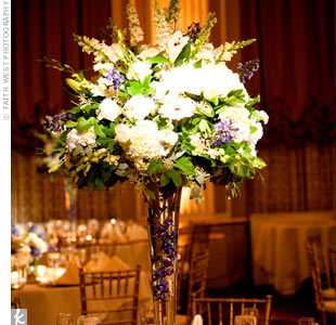 Tall vases were filled with submerged orchids and a mix of purple and white flowers.