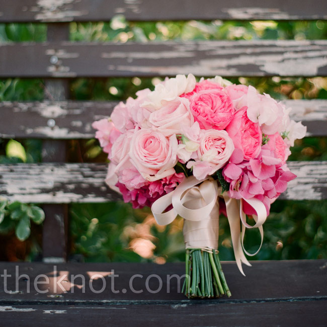 Christine held a bouquet of orchids, roses and dahlias in softer shades of pink to complement her dress.