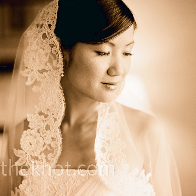 The delicate lace on Christine's mantilla veil matched the detail on the bodice of her dress.