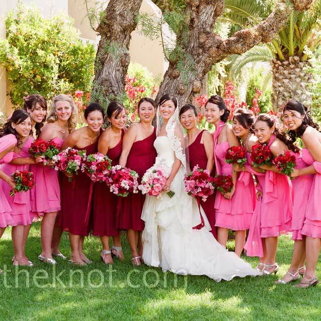While the bridesmaids wore one-shoulder dresses in merlot, the junior bridesmaids stood out in pink.