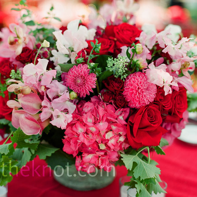 The colors (deep reds and pinks with green accents) made the arrangements of hydrangeas, dahlias and roses look even more lush.
