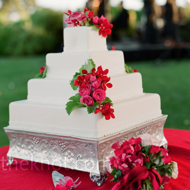 Fresh pink flowers decorated the square all-white cake.