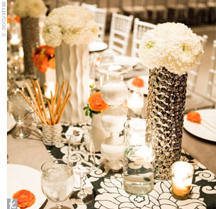 The banquet-style tables at the reception were topped with patterned runners and an eclectic collection of white and silver vases filled with monochromatic flowers.