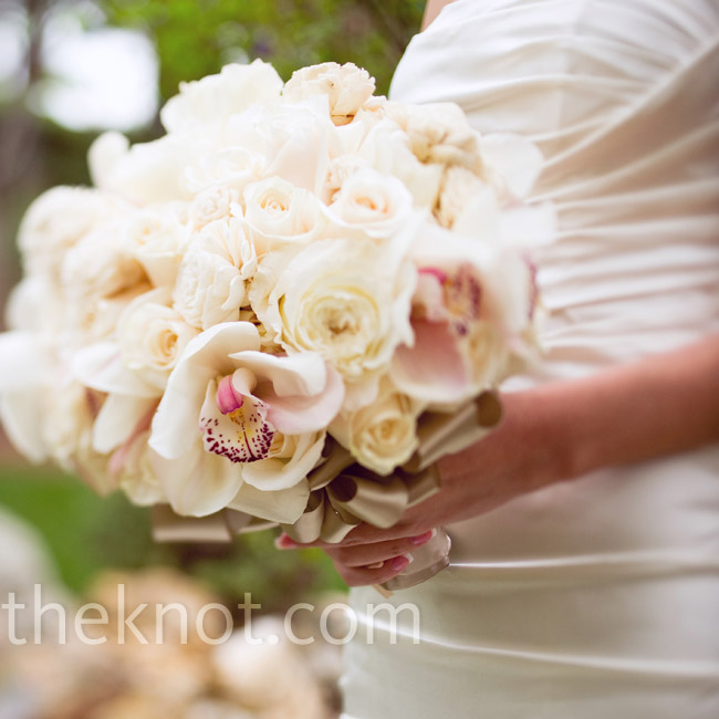 Katherine carried an all-white bouquet of roses, balsa wood flowers and cymbidium orchids wrapped in silk taffeta ribbon.