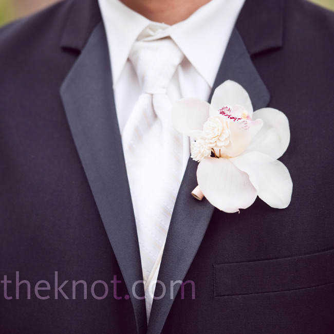 Terence's white orchid boutonniere matched Katherine's bouquet.