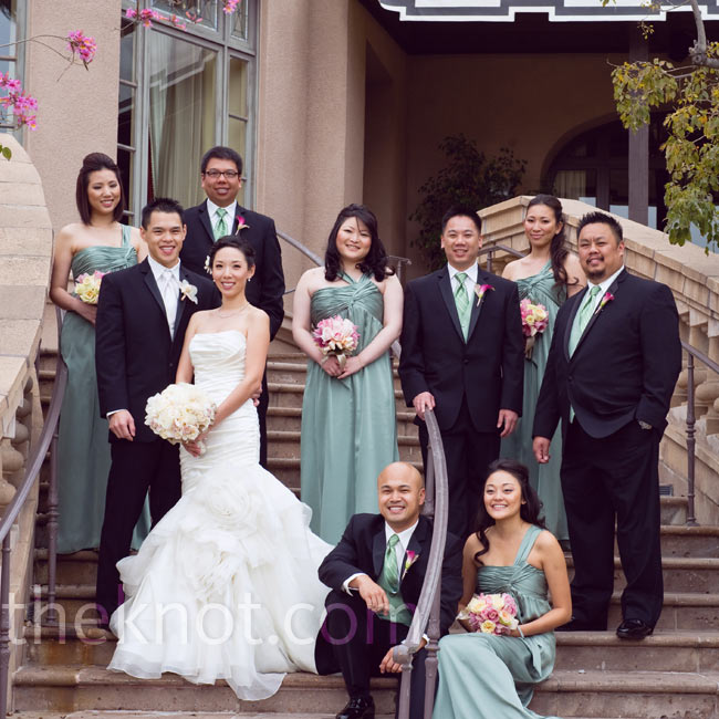 The bridesmaids wore sage-green one-shoulder gowns, and the guys wore vests and ties to match.