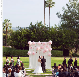 Katherine and Terence said their vows outside, before a backdrop of fabric and hanging paper flowers.