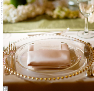 Gold-beaded chargers and blush pink napkins had a romantic and elegant look.