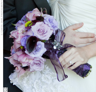 Amy's bouquet of roses, orchids, hydrangeas and calla lilies covered every shade of purple.