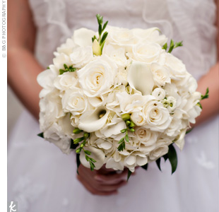 Eden held a tightly packed round bouquet of roses, hydrangeas and calla lilies with a few green accents.