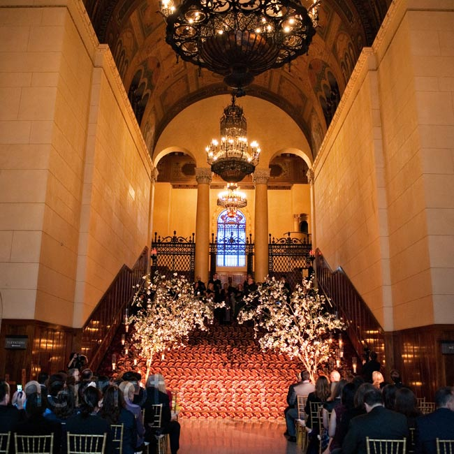 Two uplit dogwood trees and 200 candles lined the stairs for the ceremony in the Park Plaza foyer.
