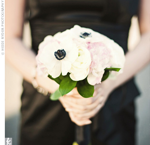 Ivory and pale pink peonies, ranunculus and white anemones popped against the girls' black dresses.