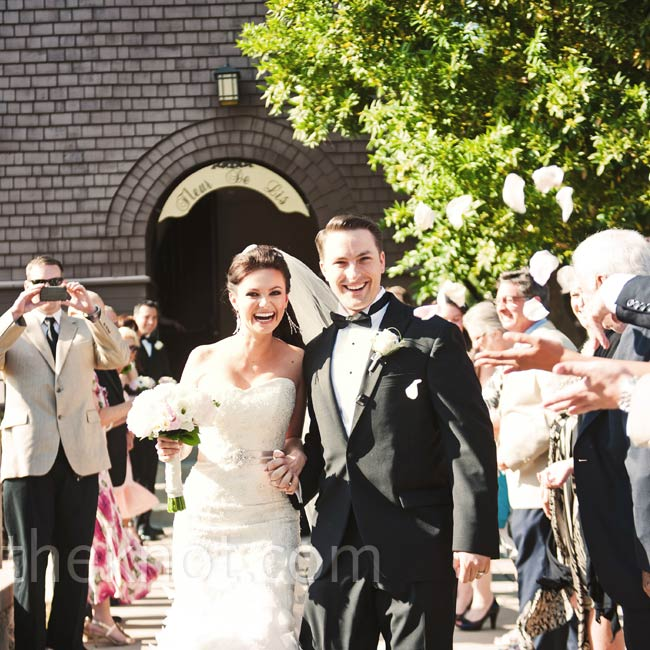 Justine and Steve wanted a traditional ceremony, so guests tossed flower petals as the couple exited the 100-year-old chapel.