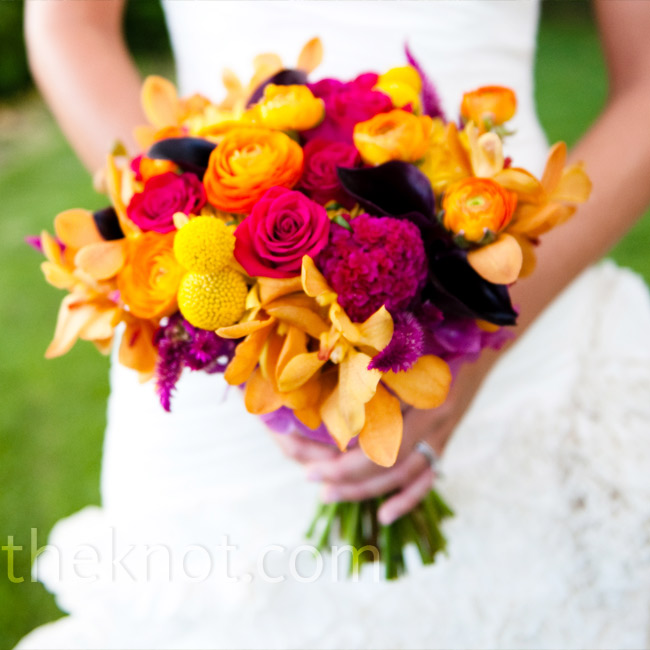 Wanting a bright pop of color against her dress, Jana carried an orange, pink and yellow mix, which included orchids, roses, ranunculus and craspedia.