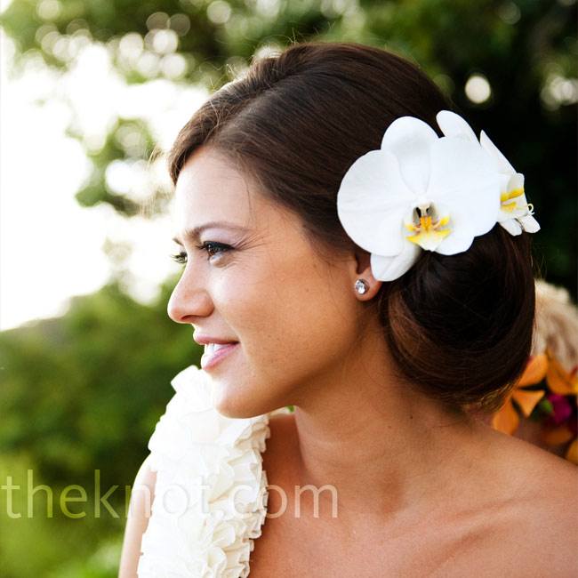 Jana went sans-veil and wore her hair in a low side bun with two white orchids.