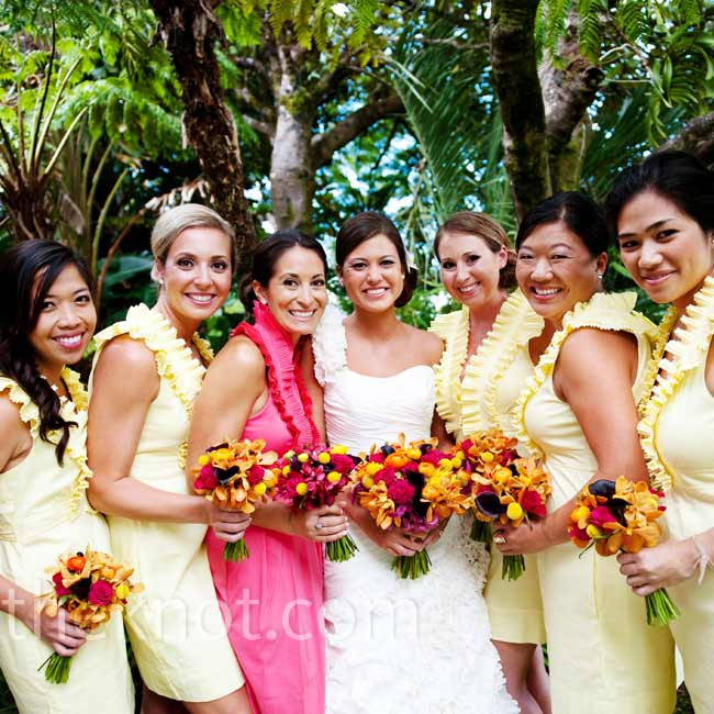 The bridesmaids all wore short cotton dresses in yellow, while the maid of honor stood out in hot pink.