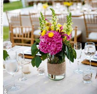 So as not to overwhelm the tables, the couple kept the centerpieces simple in twine-wrapped vases for a slightly rustic look.