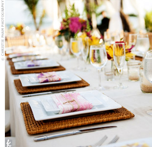 Long banquet tables with square chargers and plates brought a contemporary feel to the tables.