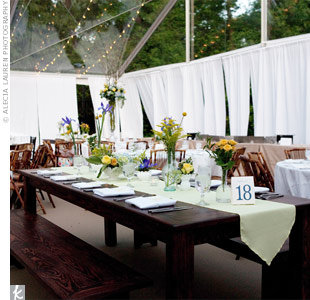 The tented reception was held on the tennis court. Inside, a variety of round and long, rustic banquet tables created a relaxed yet formal vibe.