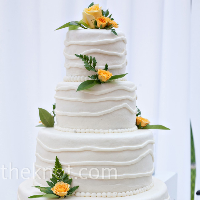Allison and Tyler served up a lemon cake covered in white chocolate frosting and adorned with yellow roses.