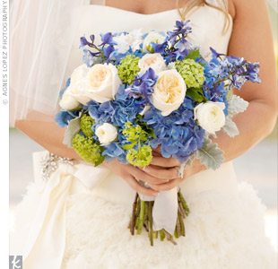 Deep blue hydrangeas were tucked in with delphinium, garden roses and dusty miller to create a romantic bouquet that tied in with the colors of the day.