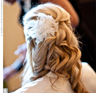 A tulle flower accented Amanda's tousled half-up hairstyle.